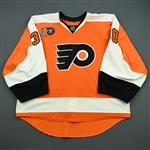 Bryzgalov, Ilya<br>Orange w/Mark Howe #2 Retirement Night Patch 3/6/12<br>Philadelphia Flyers 2011-12<br>#30 Size: 58G