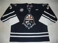 Stajcer, Scott<br>Navy Set 1<br>Greenville Road Warriors 2012-13<br>#35 Size: 58G
