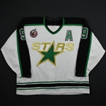 Modano, Mike *<br>White w/A - 1893-1993 Stanley Cup Patch  - Photo-Matched<br>Minnesota North Stars 1992-93<br>#9 Size: 56
