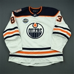 Benning, Matt<br>White Global Series Sweden w/ 40th Anniversary Patch - October 6, 2018 - 2nd Period<br>Edmonton Oilers 2018-19<br>#83 Size: 58