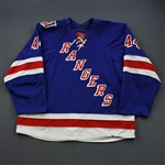 Eminger, Steve *<br>Blue w/ 85th Anniversary Patch - Worn October 2010 - December 2010<br>New York Rangers 2010-11<br>#44 Size: 58