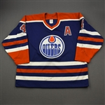 Lowe, Kevin *<br>Blue  w/A - Autographed on Crest<br>Edmonton Oilers 1990-91<br>#4 Size: 54