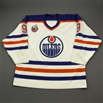 Nicholls, Bernie *<br>White w/Stanley Cup 1893-1993 100th Anniversary Patch<br>Edmonton Oilers 1992-93<br>#9 Size: 54