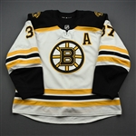 Bergeron, Patrice<br>White Set 1 w/A<br>Boston Bruins 2019-20<br>#37 Size: 58